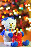 Frosty the snowman at Christmas. Funny toy figurine offering Christmas tree candy royalty free stock photo