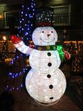 Frosty the Snowman Christmas Decoration. Photo of frosty the snowman christmas decoration at night during december royalty free stock photos