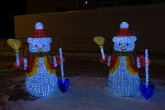 Frosty the Snowman Next to Christmas Lights on Home.  stock image