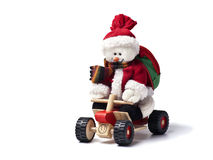 Frosty the Snowman on a Quad. Frosty the Snowman in Santa Claus costume riding a wooden Quad stock photography