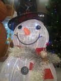 Frosty the Snowman. White, carrot nose, black hat, scarf stock photos