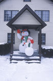 Frosty the snowman after winter snow in New Jersey during Christmas celebration in front doorway of home stock photos
