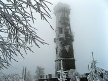 Frosty stone lookout tower in a grey winter day Royalty Free Stock Images