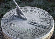 Frosty Sundial. Delicate covering of frost enhancing the detail on a sundial Stock Image