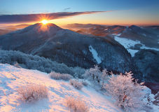A frosty sunrise in beauty mountains Stock Photos