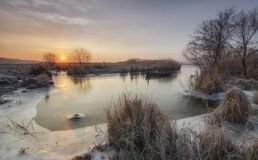 Frosty sunrise on the river Ingul stock photo