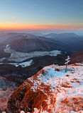 A frosty sunset in mountains Stock Images