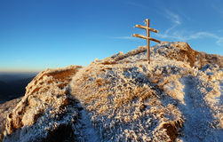A frosty sunset in mountains with cross Stock Photography