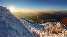 A frosty sunset panorama in beauty mountains. Stock Image