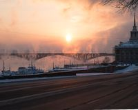 Frosty sunset with steam from the river Stock Image
