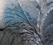 Frosty texture on glass. Frost on the glass, frozen water on glass, frost paints on glass Royalty Free Stock Images