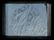 Frosty texture on glass. Frost on the glass, frozen water on glass, frost paints on glass Stock Photography