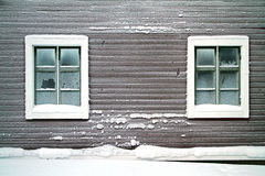Frosty wall. Of old wooden house with two frosty windows stock images