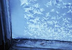Frosty window. Picture of window with hoarfrost in cold colours Royalty Free Stock Images