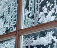 Frosty window ornament. Frost icy flowers on a window glass Stock Photo