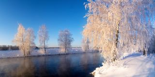 Frosty winter morning landscape with mist and forest river, Russia, Ural Royalty Free Stock Photography