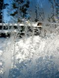 Frosty winter patterns on the glass. Vertical background.  stock photos