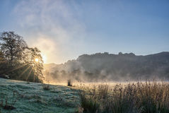A frosty winter sunrise next to Rydal Water in the Lake District Royalty Free Stock Images