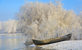 Frosty winter trees and boat Royalty Free Stock Photo