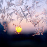 Frosty winter window, sunset Royalty Free Stock Image