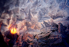 Frosty winter window, sunset Stock Images