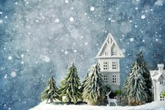 Frosty winter wonderland forest with snowfall, houses and trees. Christmas greetings concept. Frosty winter wonderland forest with snowfall, houses and trees royalty free stock photo