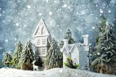 Frosty winter wonderland forest with snowfall, houses and trees. Christmas greetings concept. Frosty winter wonderland forest with snowfall, houses and trees stock photos