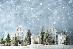 Frosty winter wonderland forest with snowfall, houses and trees. Christmas greetings concept. Frosty winter wonderland forest with snowfall, houses and trees royalty free stock photography
