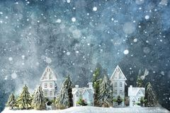 Frosty winter wonderland forest with snowfall, houses and trees. Christmas greetings concept. Frosty winter wonderland forest with snowfall, houses and trees stock image