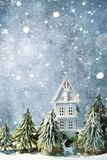 Frosty winter wonderland forest with snowfall, houses and trees. Christmas greetings concept. Frosty winter wonderland forest with snowfall, houses and trees stock images