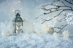 Frosty winter wonderland with snowfall and magic lights. Christmas greeting card. Copy space stock photography
