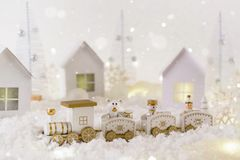 Frosty winter wonderland with toy train, snowfall and magic lights. Christmas greetings concept stock photo