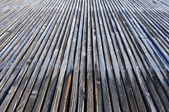 Frosty wooden planks converge in the distance. stock photography