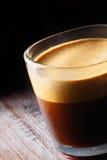 Frothy aromatic mug of fresh coffee Stock Image