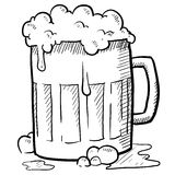 Frothy beer mug Royalty Free Stock Images