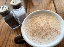 Frothy Chai Latte with Cinnamon royalty free stock images