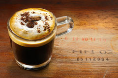 Frothy cup of cappuccino coffee Royalty Free Stock Photo