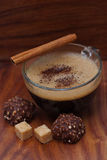 Frothy cup of espresso coffee with cinnamon, chocolate Stock Photography