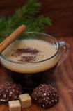 Frothy cup of espresso coffee with cinnamon, chocolate Royalty Free Stock Photo