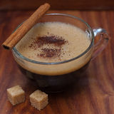 Frothy cup of espresso coffee with cinnamon Stock Photo
