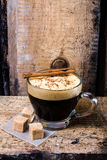 Frothy Cup of Espresso  coffee  on rustic brutal dark wooden bac Royalty Free Stock Photo