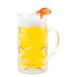 Frothy glass of beer with a prawn. Frothy glass of light golden beer with a single cooked pink prawn balanced carefully on the rim isolated on white Royalty Free Stock Photos