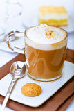 Frothy Mug Of Aromatic Cappuccino Royalty Free Stock Photography