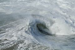 Frothy wave breaking in the Pacific Ocean. Large blue Royalty Free Stock Photos