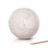 Frottez la carte de l'Asie et de l'Australie sur le globe de papier Images stock