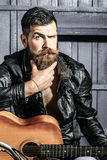 Frown bearded man hipster biker Stock Images