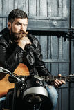 Frown bearded man hipster biker Royalty Free Stock Image