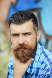 Frown bearded man outdoor Stock Photo