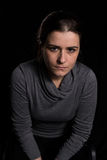 Frown woman Stock Images