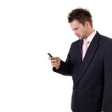 Frowned businessman with cell phone Royalty Free Stock Photography